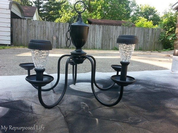 repurposed chandelier as a solar light
