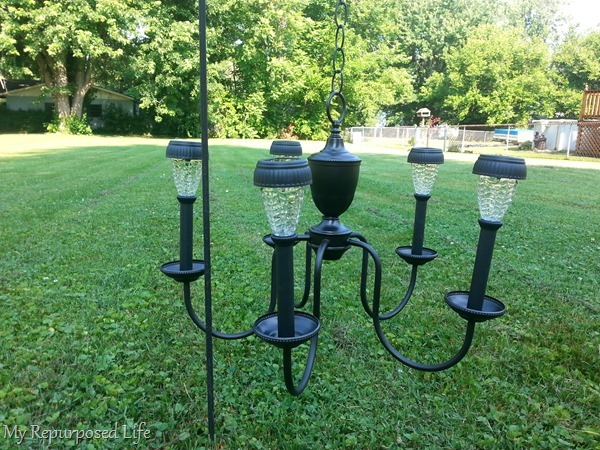 solar lights on repurposed chandelier