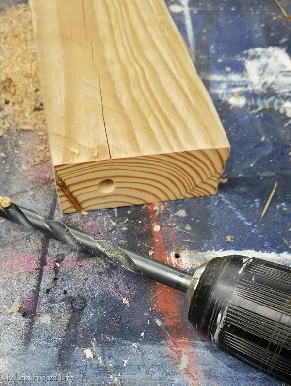 drill 2 holes in bottom of 2x4