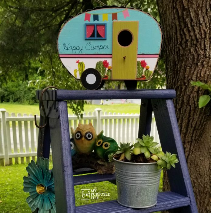 use a painted wooden ladder in the yard as a plant stand MyRepurposedLife