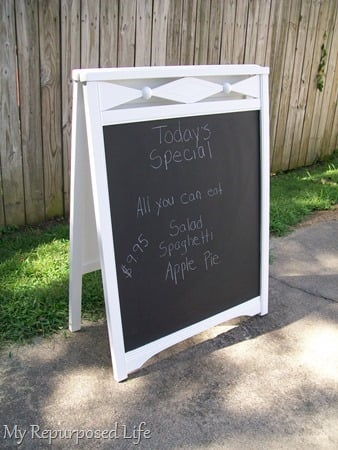 repurposed crib chalkboard easel