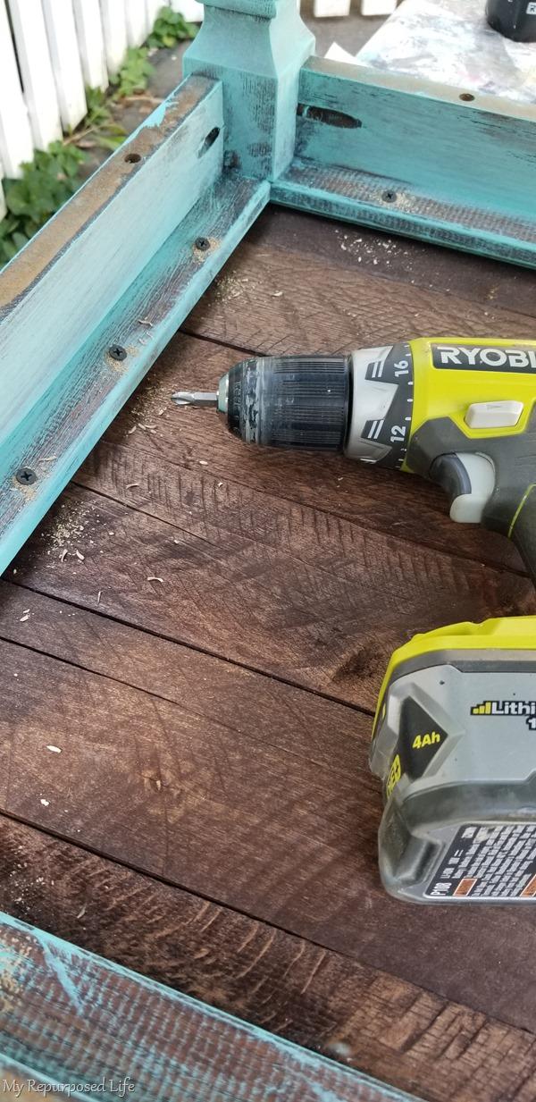 screws secure pallet table top on rustic side table