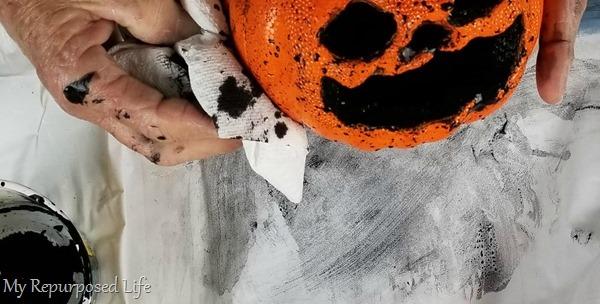 add black paint to inside of foam pumpkin jack-o-lantern