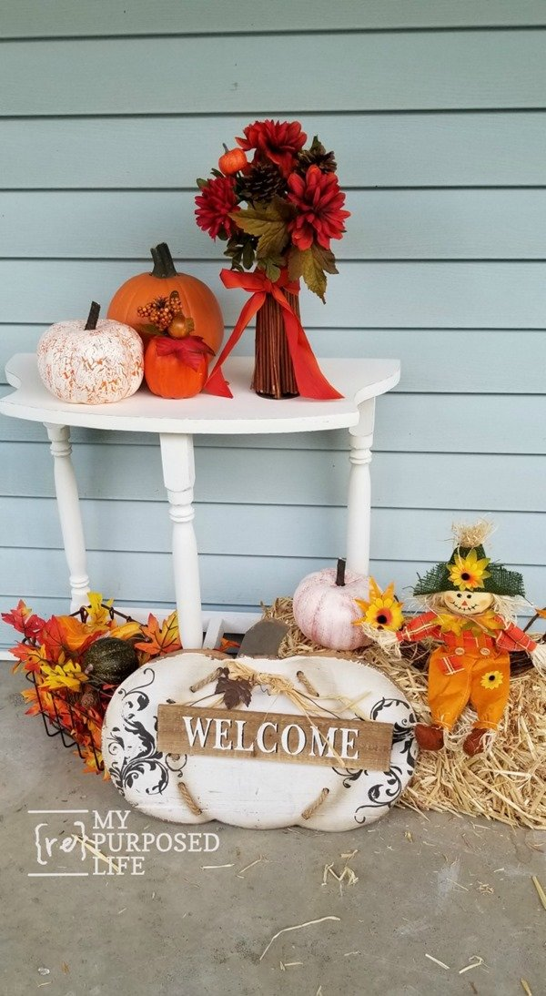 A thrift store table gets a quick makeover just in time to be the star of a Fall porch. Tips on painting, distressing and repairing furniture. This easy makeover will have you looking for small side tables at your local thrift store. #MyRepurposedLife #furniture #makeover #fall #porch #decor #distressing via @repurposedlife
