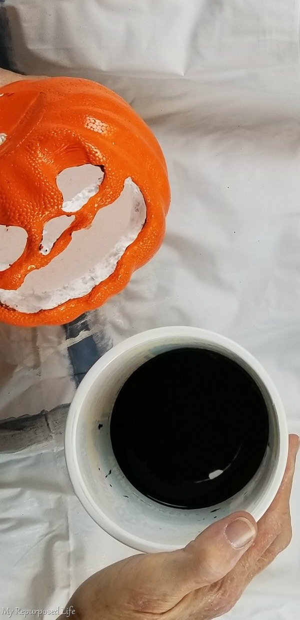 pour diluted paint into carved foam pumpkin