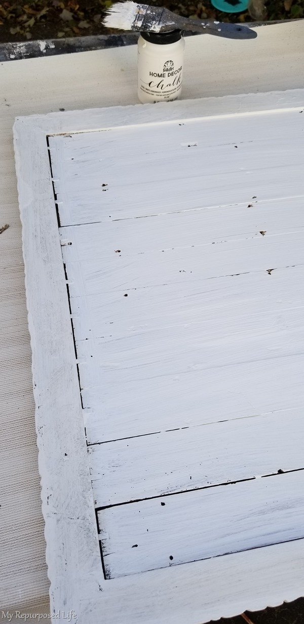 paint back side of beachy frame with chalk paint