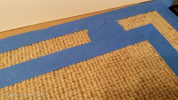 taping the border for a spray painted rug