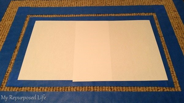 use paper to protect unpainted area of rug