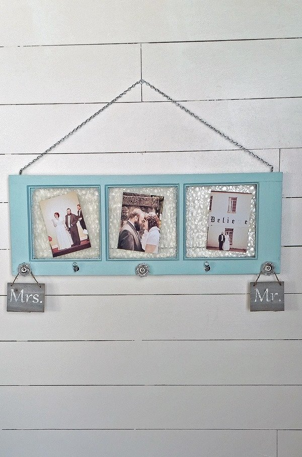 How to turn a vintage frosted bathroom window into a unique and handy coat rack and more. Display photos on the glass and use the hooks for hanging scarves, jewelry and more. #MyRepurposedLife #upcycle #window #wedding #jewelry #scarf #organization via @repurposedlife