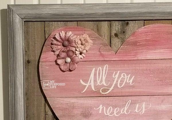 embellish reclaimed wood heart with paper flowers MyRepurposedLife