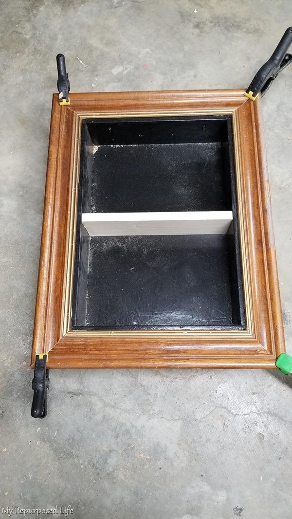 glue and clamp frame around shadow box