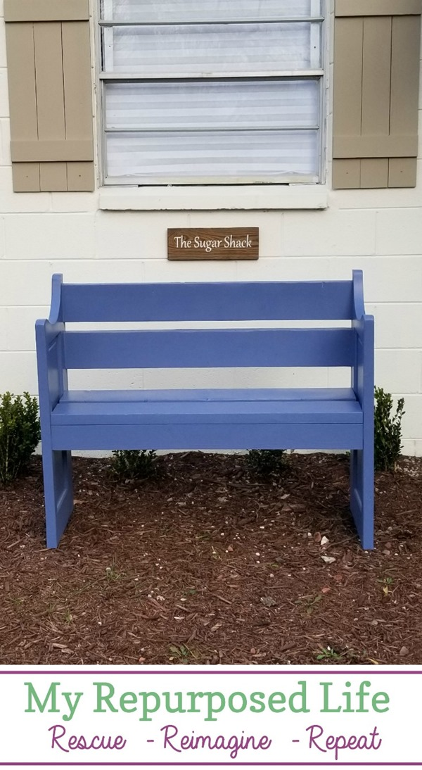 small blue bench made from a door and reclaimed lumber MyRepurposedLife