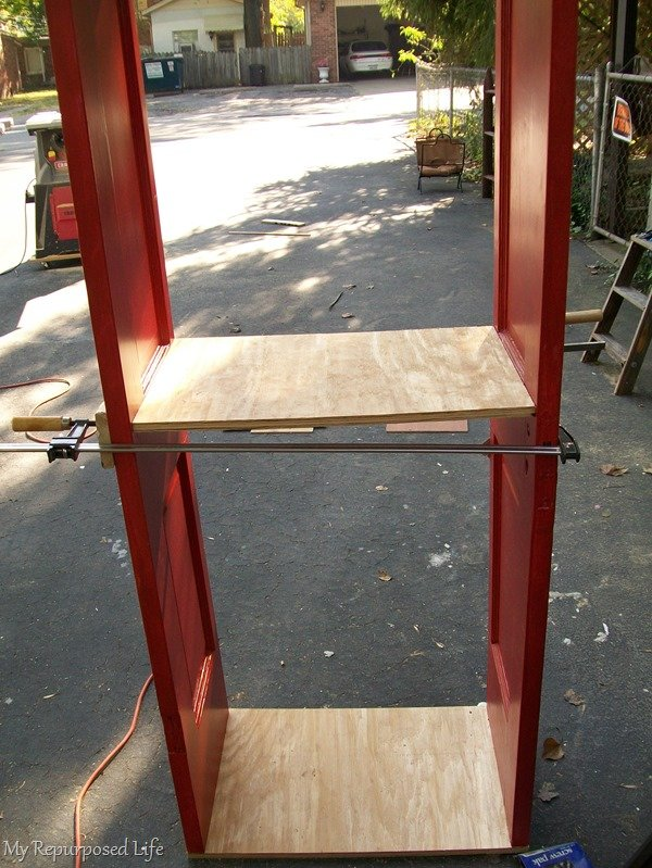 assembling a repurposed door bookshelf