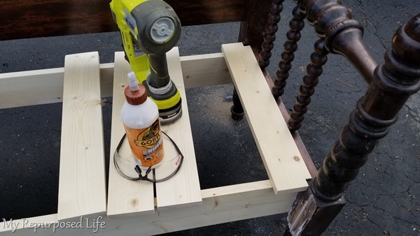 attach bench seat boards with wood glue and nail gun