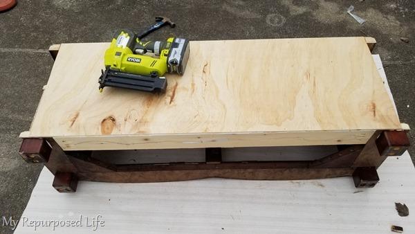 nail gun secures plywood back