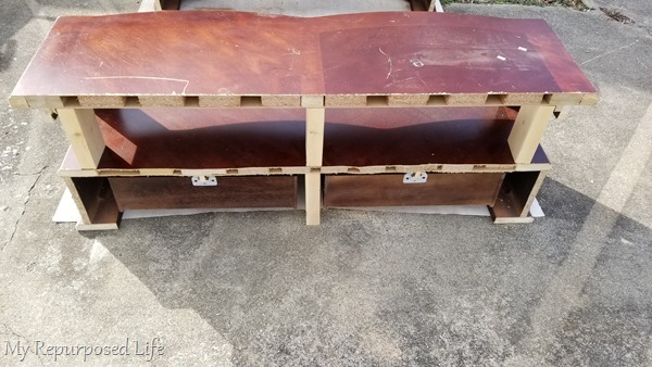 one half of over sized coffee table cut in half
