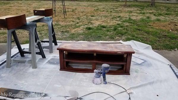 painting children's storage bench with paint sprayer