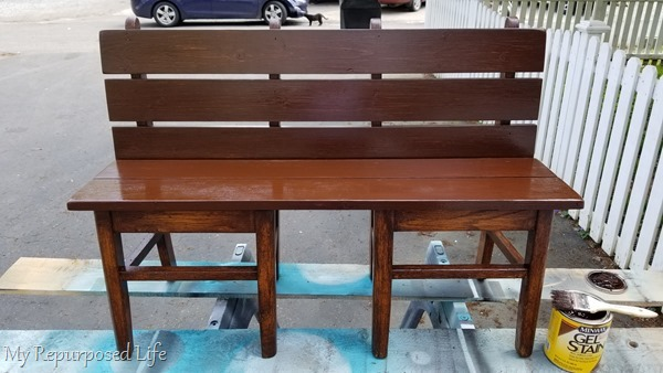 apply second coat of stain on chair bench