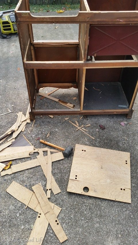 dismantling old record radio cabinet