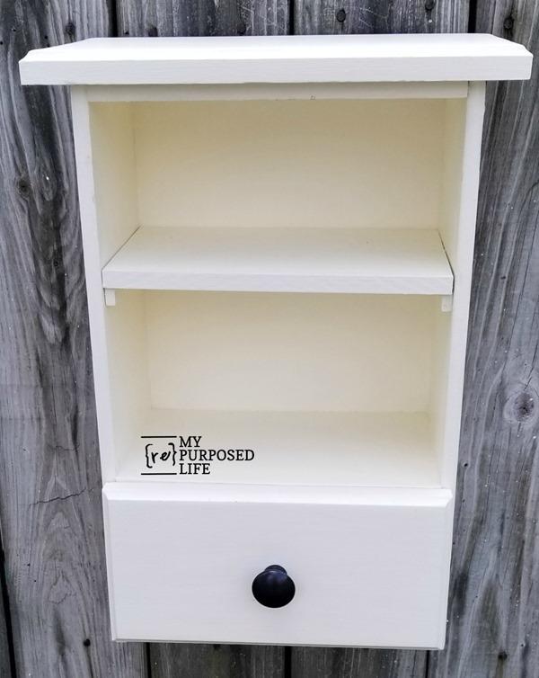 white wall cabinet made from repurposed drawers MyRepurposedLife
