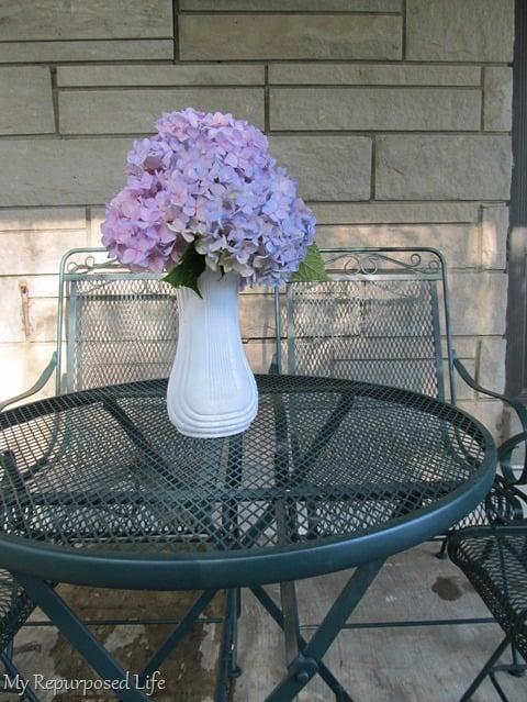 flowers on painted metal table