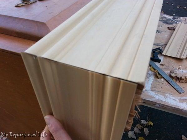 add trim to cover bad veneer