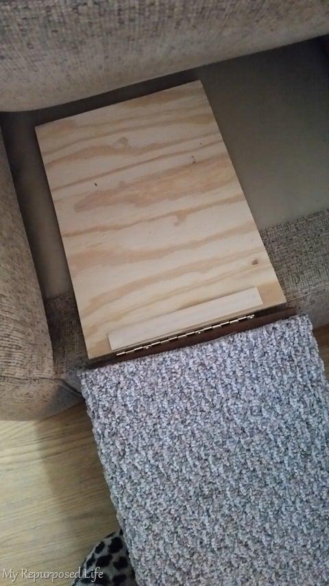diy pet ramp made from a repurposed cabinet door