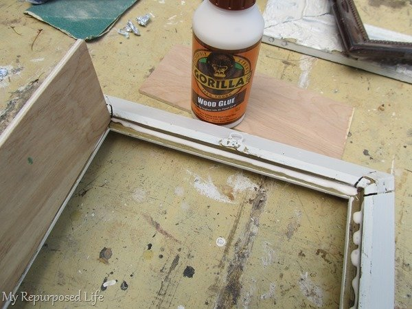 glue plywood to picture frame to make shadow box