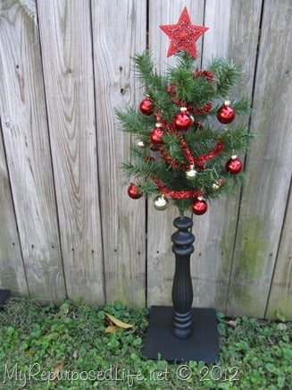 Using upcycled chair spindles and some old Christmas tree branches make a perfect little Christmas tree for small spaces such as nursing homes or hospital. #MyRepurposedLife #repurposed #chair #spindles #Christmas #tree #decor via @repurposedlife