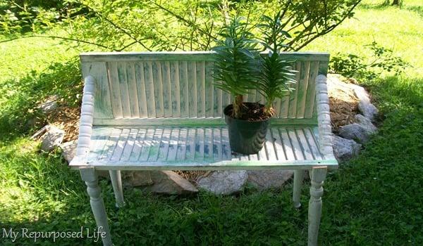 repurposed shutter bench for plants