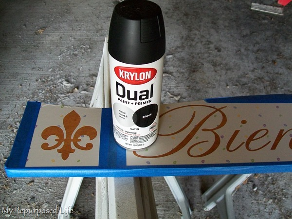 spray paint repurposed headboard sign