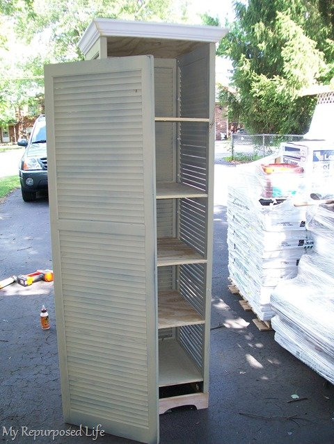 tall shutter cupboard