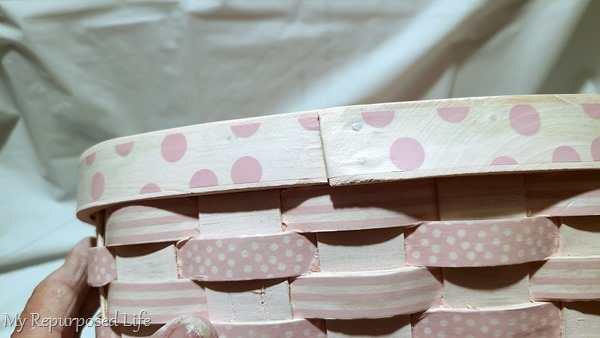 add wide washi tape to top band of basket from the back