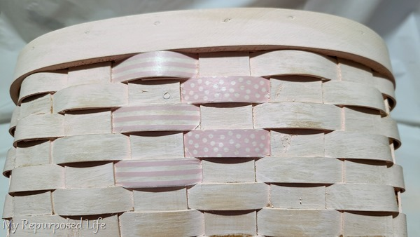 adding washi tape to a wicker basket