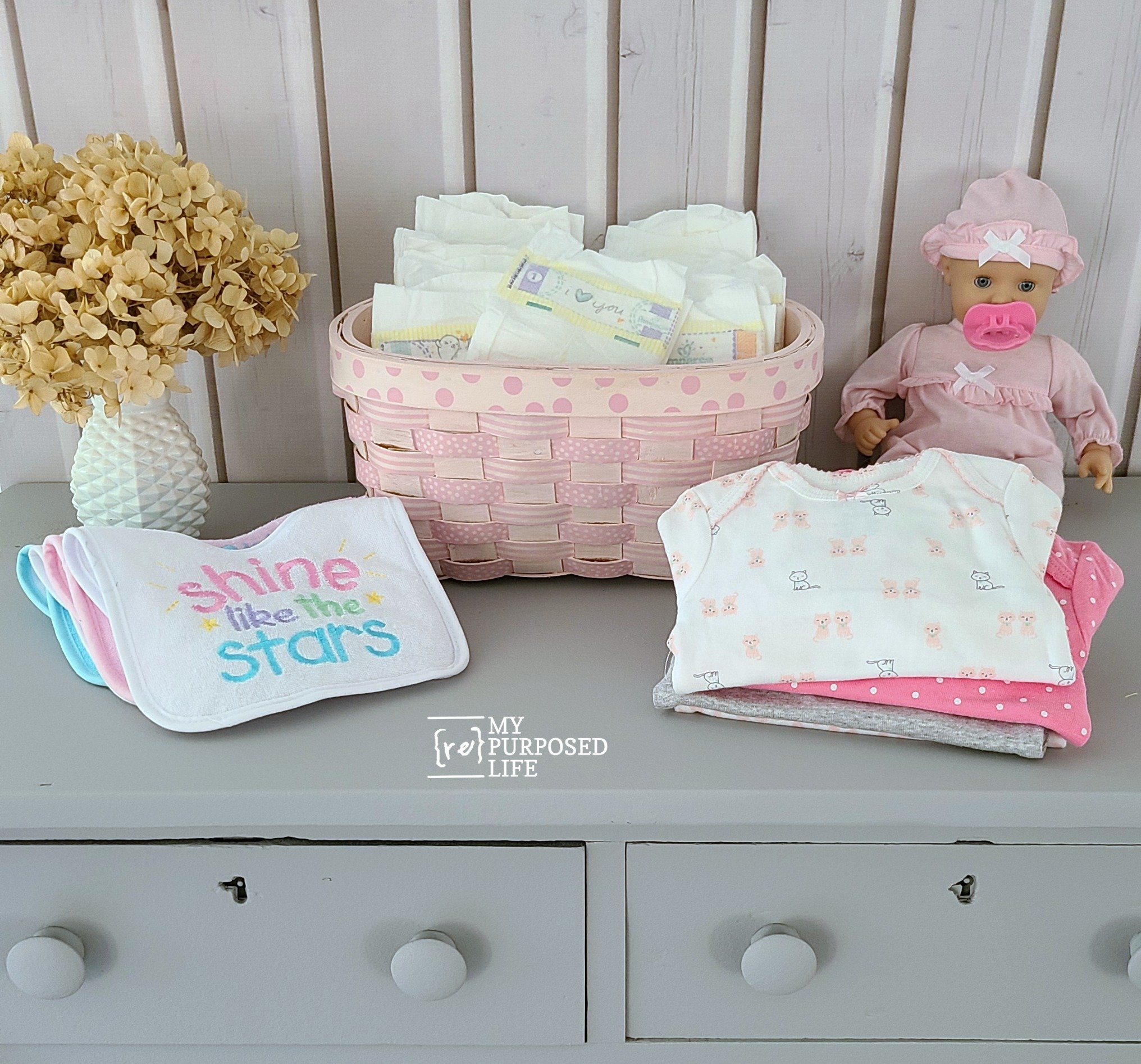 washi tape on a pink basket to hold diapers MyRepurposedLife