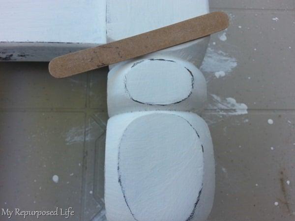 light paint distressing using an emery board