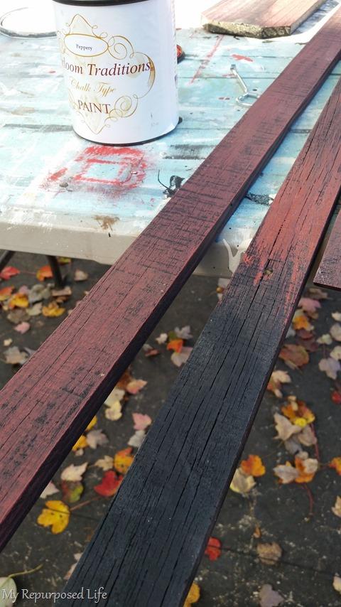 dry brush red over black rustic frame