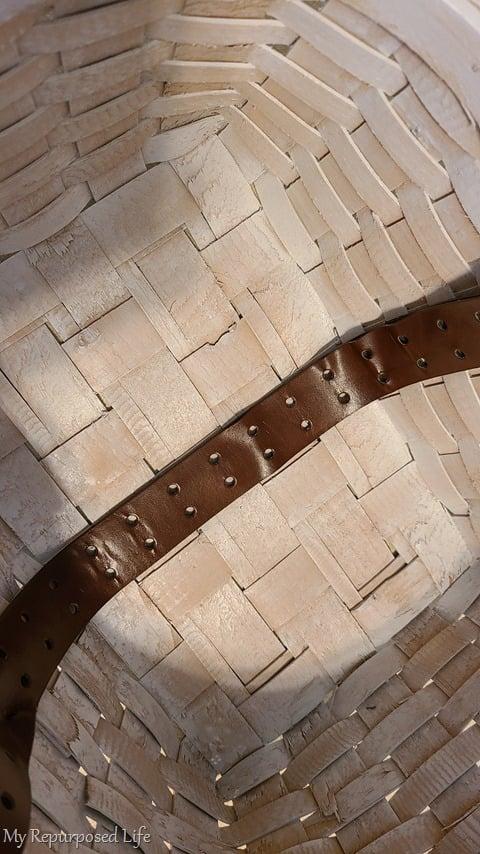 leather belt inside thrift store basket
