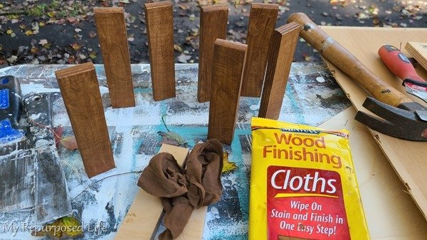 easily stain small scrap wood ornaments