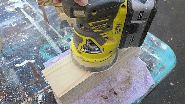 place short lumber on a rag to sand