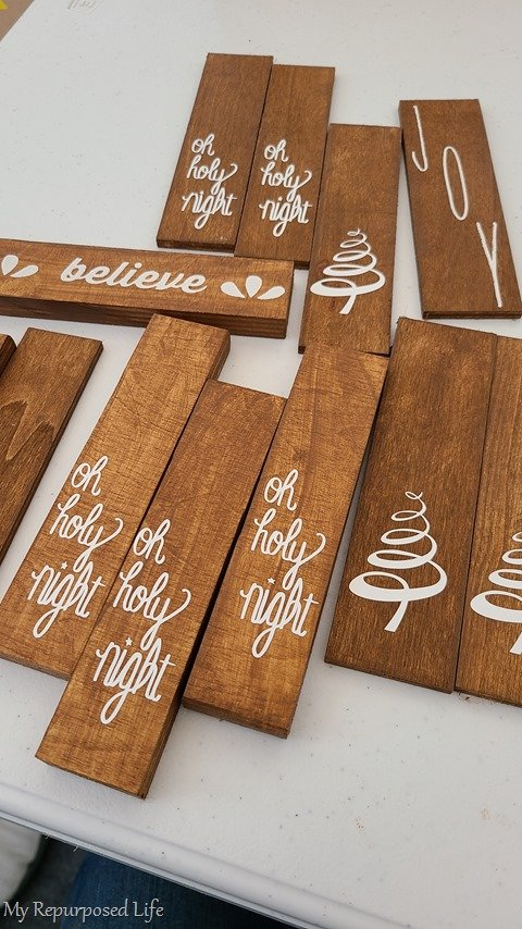 scrap wood ornaments with vinyl and chalk paste