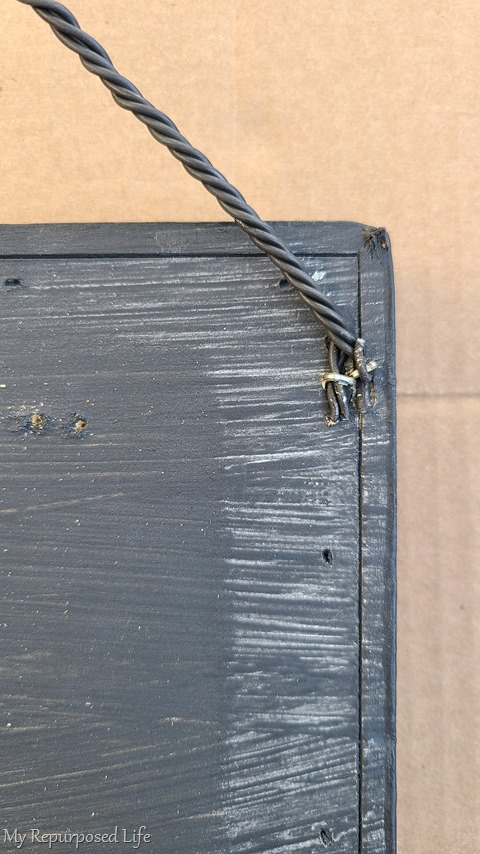 staple wire hanger on drawer front sign