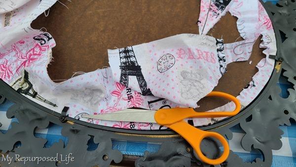 trim fabric close to edge of frame