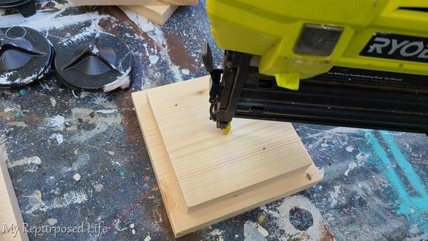 wood glue and nail gun assembles base for pedestal