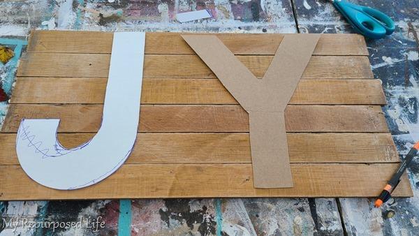 cardboard letter templates on reclaimed oak flooring