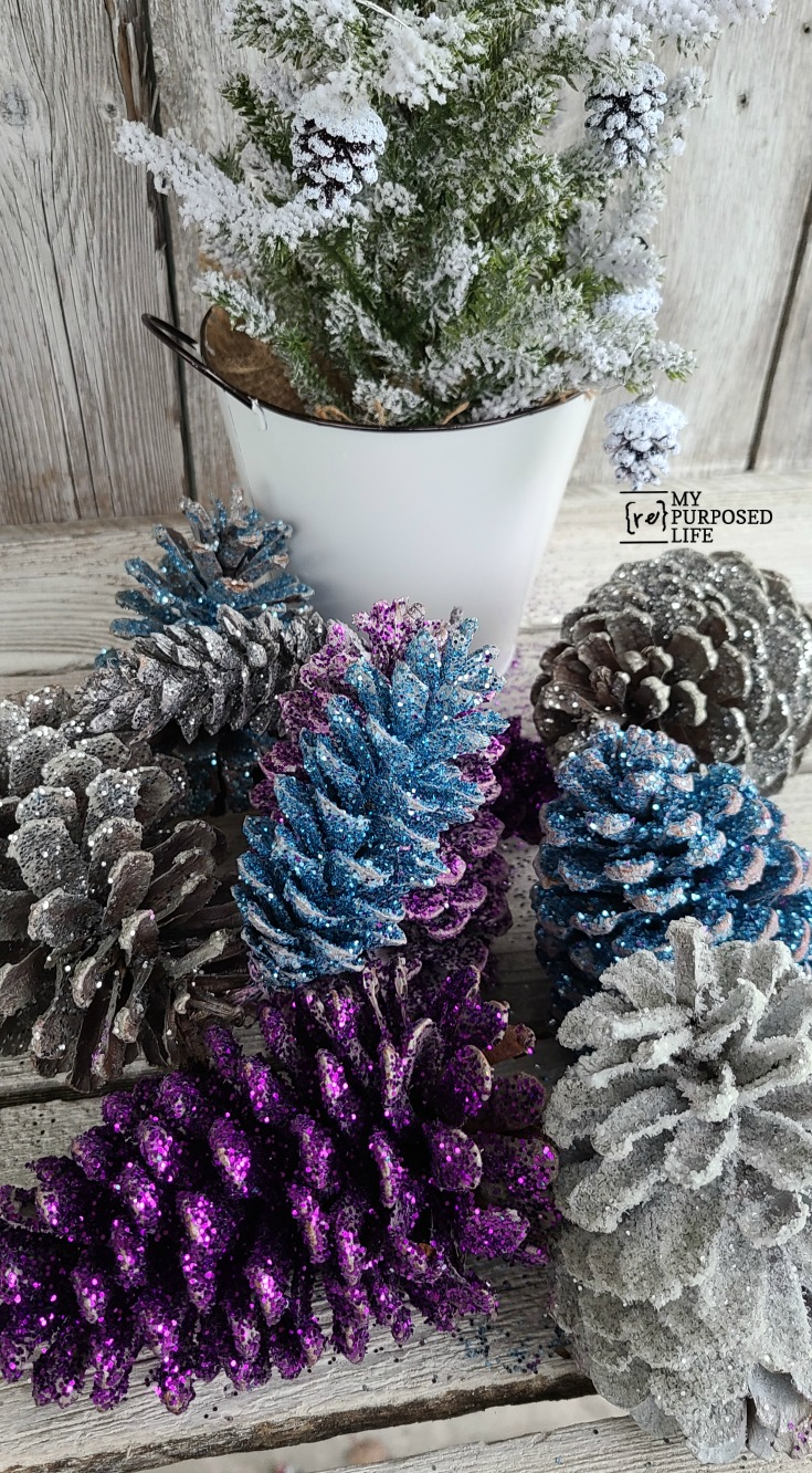 How to make pretty, colorful glittered pine cones for your home decor. Lots of tips and tidbits to make this an easy afternoon project. #MyRepurposedLife #Christmas #easy #decor #diy #project via @repurposedlife