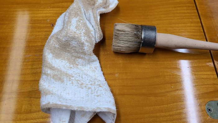 apply deglosser with paintbrush and rag