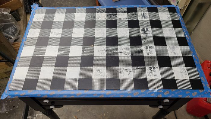 top of sewing cabinet craft table with buffalo plaid pattern