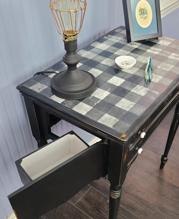 closeup of distressed buffalo plaid table