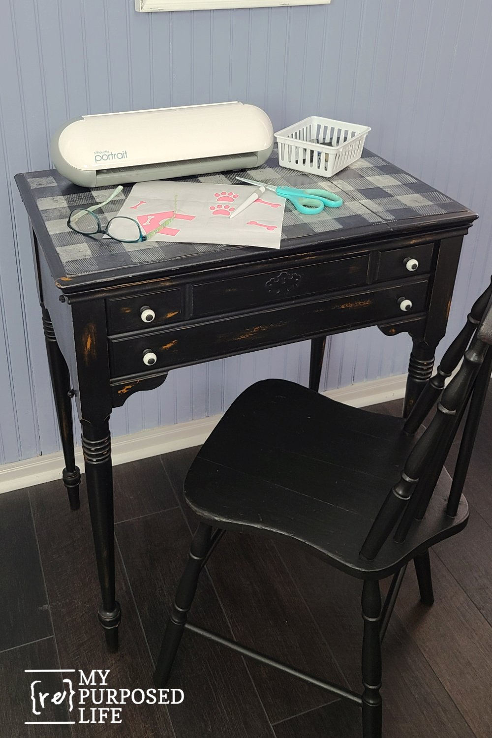 A sewing machine cabinet turned into a craft table. Also perfect as a laptop desk or a homework station for the kids. Hidden storage is a bonus! How to disguise a really bad table top! #MyRepurposedLife #repurposed #furniture #sewingcabinet #crafttable via @repurposedlife